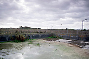 © Licensed to London News Pictures. 22/10/2017. Bawdsey, UK.  A well contained stagnant water. RAF Bawdsey, WW2 radar and Cold-War Bloodhound Surface to Air Missile (SAM) base at Bawdsey Ferry, Suffolk, today 22nd October 2017. The base was decommissioned in 1991 leaving behind a deserted base.  Photo credit: Stephen Simpson/LNP