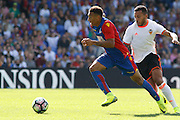 Crystal Palace defender Zeki Fryers (19) gets past Valencia defender Ruben Vezo (3) during the Pre-Season Friendly match between Crystal Palace and Valencia CF at Selhurst Park, London, England on 6 August 2016. Photo by Andy Walter.