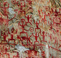 closeup image of the Huashan Ancient Murals or rock paintings on the cliffs that line the Ming River in Guangxi Province.
