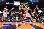Jan 3, 2017; Phoenix, AZ, USA;  Miami Heat guard Goran Dragic (7) handles the ball against Phoenix Suns forward Marquese Chriss (0) in the first half of the NBA game at Talking Stick Resort Arena. Mandatory Credit: Jennifer Stewart-USA TODAY Sports