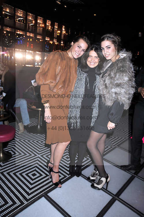 Left to right, YASMIN LE BON, DANIELLA HELAYAL and AMBER LE BON at a party following the Issa fashion show at the February 2009 Fashion Week held at Raffles, King's Road, London on 23rd February 2009.