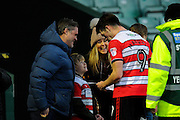 John Marquis (9) of Doncaster Rovers goes to a young fan to sign his autograph at full time, after Doncaster's 3-0 win over Yeovil during the EFL Sky Bet League 2 match between Yeovil Town and Doncaster Rovers at Huish Park, Yeovil, England on 28 January 2017. Photo by Graham Hunt.