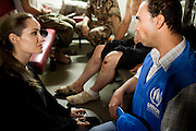 Jordan: UNHCR Special Envoy Angelina Jolie meets with refugees and UNHCR Representatives on the Jordanian border minutes after they crossed from Syria. With shelling clearly audible and visible across the border in Syria, some 200 refugees made the dangerous crossing under cover of night. ..Authorities estimate hundreds of families are fleeing the violence and seeking safety across the border every night....©UNHCR/JTanner/Sept 2012