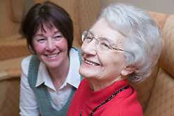 Older woman and carer in a care home,
