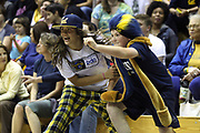 Kylie Horstmeyer, age 12, left, and Pj Pfeiffer, age 12, battle to grab the basketball before the California Bears and Wichita State NCAA tournament women's college basketball game at the Haas Pavilion, Friday, March 20, 2015, in Berkeley, Calif.