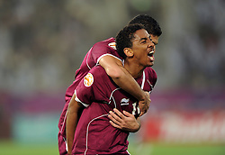 Mohamed Elsayed of Qatar celebrates after scoring a goal to make it 2-0 with Talal Al-Bloushi