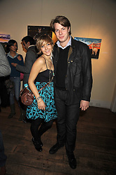 GEORGE SIMON and CAMILLA BOLER at an exhibition of Sarah-Jane Boler's paintings entitled 'Life on The Farm' held at The Troubadour, 265 Old Brompton Road, London on 27th November 2008.