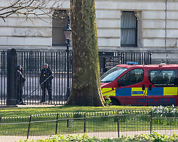© Licensed to London News Pictures. 27/03/2020. London, UK. A Police van guards the back of Downing Street as Prime Minister Boris Johnson reveals he has contracted coronavirus and is in self-isolation as the coronavirus crisis continues. Photo credit: Alex Lentati/LNP