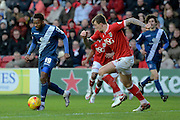 Bristol City defender Aden Flint tracks Birmingham City midfielder Jacques Maghoma during the Sky Bet Championship match between Bristol City and Birmingham City at Ashton Gate, Bristol, England on 30 January 2016. Photo by Alan Franklin.