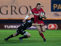Scarlets' Hadleigh Parkes is tackled by Toulon's Francois Trinh-Duc<br /> <br /> Photographer Simon King/Replay Images<br /> <br /> European Rugby Champions Cup Round 6 - Scarlets v Toulon - Saturday 20th January 2018 - Parc Y Scarlets - Llanelli<br /> <br /> World Copyright © Replay Images . All rights reserved. info@replayimages.co.uk - http://replayimages.co.uk
