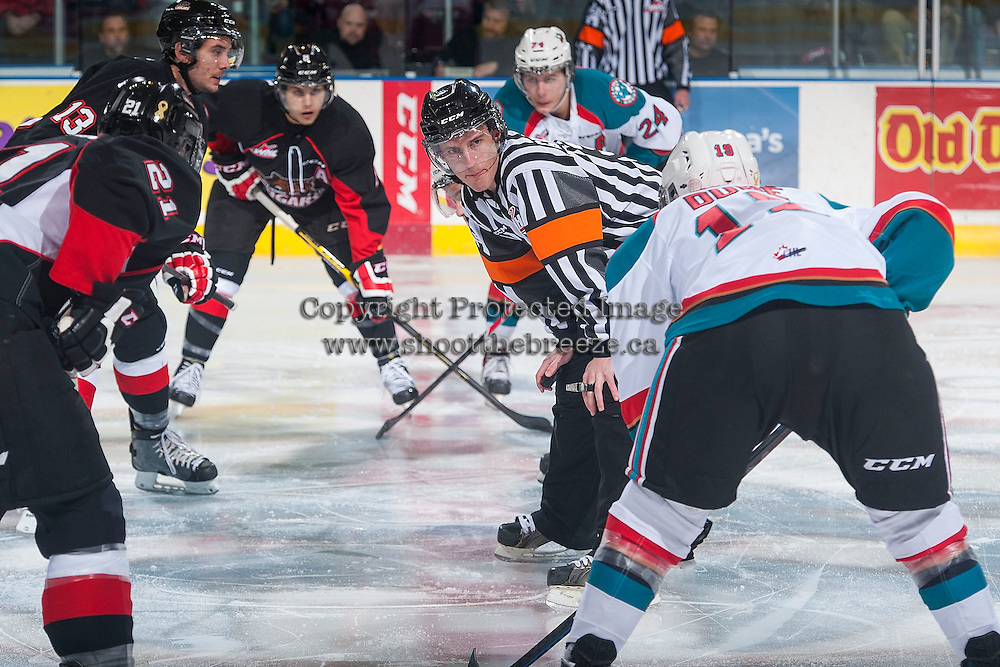 KELOWNA, CANADA - DECEMBER 30: Adam Griffiths, referee, stands at centre ice between the Kelowna Rockets and the Prince George Cougars on December 30, 2014 at Prospera Place in Kelowna, British Columbia, Canada.  (Photo by Marissa Baecker/Shoot the Breeze)  *** Local Caption *** Adam Griffiths;