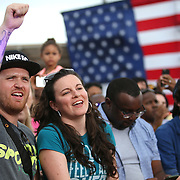 Supporters watch as President Barack Obama campaigns for Democratic nominee Hillary Clinton at Osceola Park in Kissimmee Florida USA  06 Nov 2016