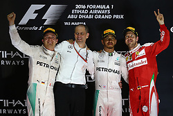 Rennen des Grand Prix von Abu Dhabi auf dem Yas Marina Circuit / 271116<br /> <br /> 1st place Lewis Hamilton (GBR) Mercedes AMG F1 W07 , 2nd place and new world champion Nico Rosberg (GER) Mercedes AMG Petronas F1 W07 and 3rd place Sebastian Vettel (GER) Scuderia Ferrari SF16-H.<br /> 27.11.2016. Formula 1 World Championship, Rd 21, Abu Dhabi Grand Prix, Yas Marina Circuit, Abu Dhabi, Race Day.