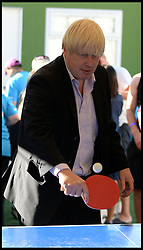 Boris Johnson playing Table Tennis backstage at the Celebration of the 2012 Olympic Games volunteering one year on at the  Queen Elizabeth Olympic Park.<br /> Mayor of London Boris Johnson and Lord Coe will be taking to the stage at Go Local to encourage a new drive in volunteering one year on from the Games. Also present are multi-platinum selling pop rock band McFly; world famous comedian Eddie Izzard, Brit Award nominated The Feeling, and Britain'Got Talent winners Attraction, in addition to stars Jack Carroll and Gabz. The event will be the UKs biggest ever celebration of volunteering and first Olympic and Paralympic legacy event at Queen Elizabeth Olympic Park.<br /> London, United Kingdom<br /> Friday, 19th July 2013<br /> Picture by Andrew Parsons / i-Images