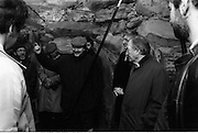 Taoiseach Visits Newgrange.  (R70)..1987..21.12.1987..12.21.1987..21st December 1987..An Taoiseach, Charles Haughey TD, visited the Newgrange Stoneage Chamber to view thwe annual Winter Soltice. As the sun rose, An Taoiseach watched as the sunrise traced its path along the floor of the chamber...Image shows An Taoiseach, Charles Haughey, listening to the explanation of the significance of the solstice and its meaning to the ancient druids who built the chamber.