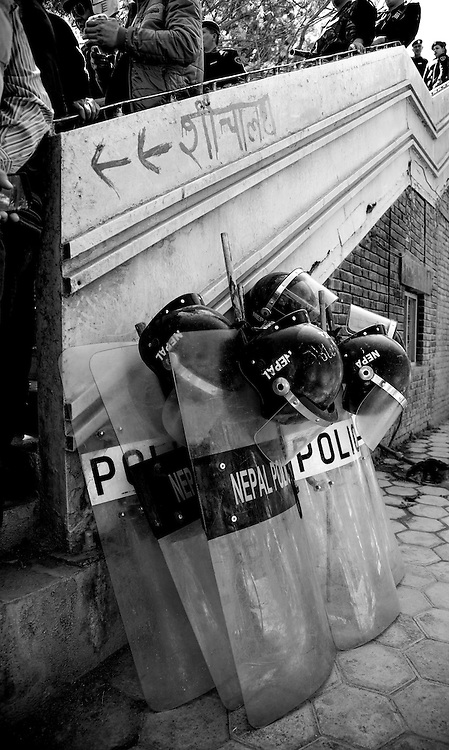 Police riot gear stacked against some stairs in Kathmandu, Nepal