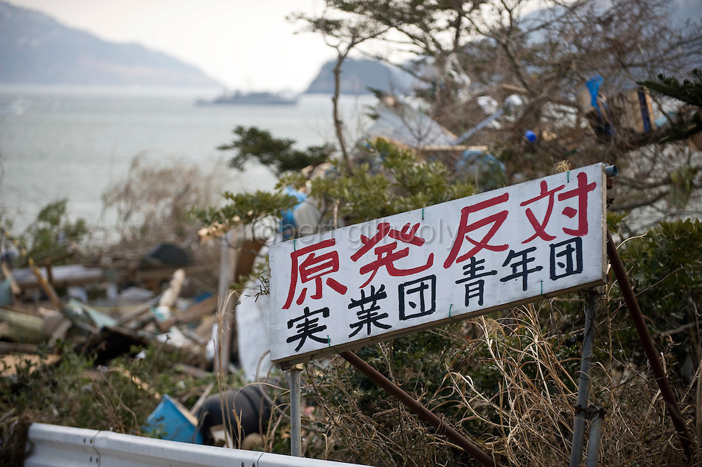 A sign expressing anti-nuclear energy sentiments  stands at the entrance to the village of Yoriisohama in Ishinomaki, Japan on 19 March, 2011.  Photographer: Robert Gilhooly