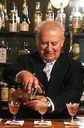 SPAIN, MADRID, ENTERTAINMENT Chicote, famous tapas bar with the barman Antonio pouring drinks