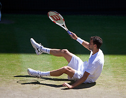 LONDON, ENGLAND - Friday, July 4, 2014: Grigor Dimitrov (BUL) slips over during the Gentlemen's Singles Semi-Final match on day eleven of the Wimbledon Lawn Tennis Championships at the All England Lawn Tennis and Croquet Club. (Pic by David Rawcliffe/Propaganda)