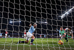 Manchester City's Sergio Aguero (centre) scores his side's third goal of the game during the Premier League match at the Etihad Stadium, Manchester.