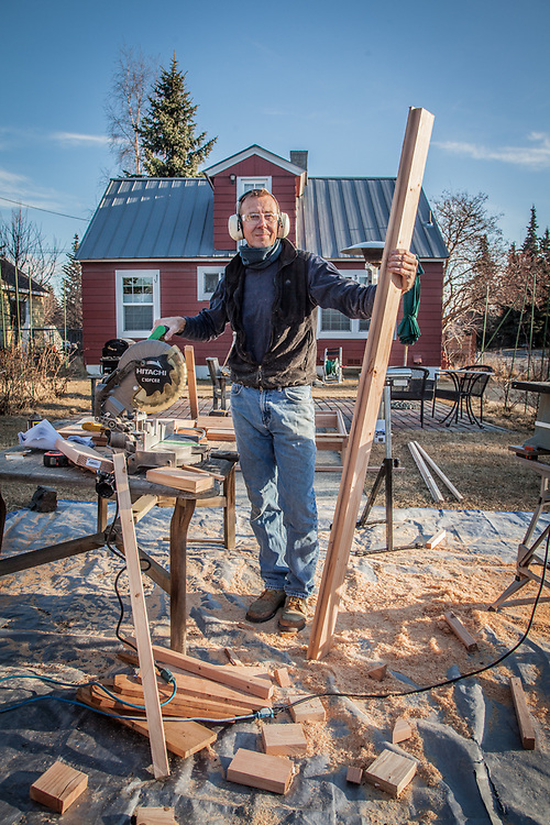 "Neighbor Jan-Ake Schultz in his yard.  ""I'm building nine beds for my six cabins on Kenai Lake…I never imagined it would take so much time.""  jaischultz2@yahoo.com"