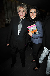 NICK RHODES and LAUREN KEMP at the launch of Nicky Haslam's autobiography Redeeming Features held at Aqua Nueva, 240 regent Street, London on 5th November 2009.