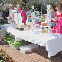 (Floyd Ingram / Buy at photos.chickasawjournal.com)<br /> Betty Holder, on right, looks through a display of cards and stationary at the Art In The Park, a fundraiser for the T.K. Martin Center held in Downtown Houston at noon Thursday, Oct. 27, 2016.