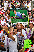 """13 JANUARY 2014 - BANGKOK, THAILAND: An anti-government protestor in Lumpini Park holds up a caricature of former Prime Minister Thaksin Shinawatra riding his sister, current Prime Minister Yingluck Shinawatra, who is portrayed as having the body of a monitor lizard. It is considered a great insult to be portrayed as a monitor lizard in Thailand. Tens of thousands of Thai anti-government protestors took to the streets of Bangkok Monday to shut down the Thai capitol. The protest was called """"Shutdown Bangkok"""" and is expected to last at least a week. The Shutdown Bangkok protest is a continuation of protests that started in early November. There have been shootings almost every night at different protests sites around Bangkok, including two Sunday night, but the protests Monday were peaceful. The malls in Bangkok stayed open Monday but many other businesses closed for the day and mass transit was swamped with both protestors and people who had to use mass transit because the roads were blocked.    PHOTO BY JACK KURTZ"""