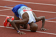 Mo Farah of Great Britain wins the  Men's 3000m and celebrates by kissing the ground during the Muller Grand Prix Birmingham 2017 at the Alexander Stadium, Birmingham, United Kingdom on 20 August 2017. Photo by Martin Cole.