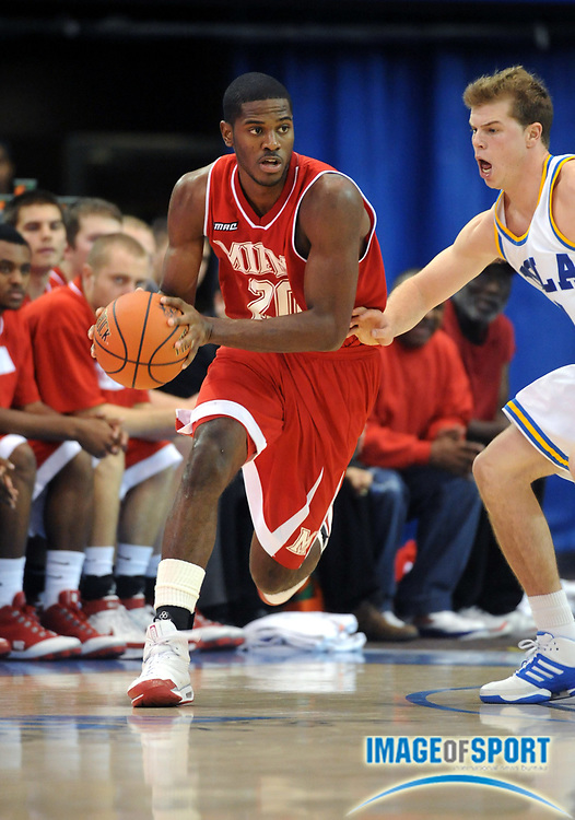 Nov 13, 2008; Los Angeles, CA, USA; Miami (OH) Redhawks forward Nick Winbush (20) dribbles during the second round of the 2K Sport Classic against the UCLA Bruins at Pauley Pavilion. UCLA defeated Miami (OH) 62-59.