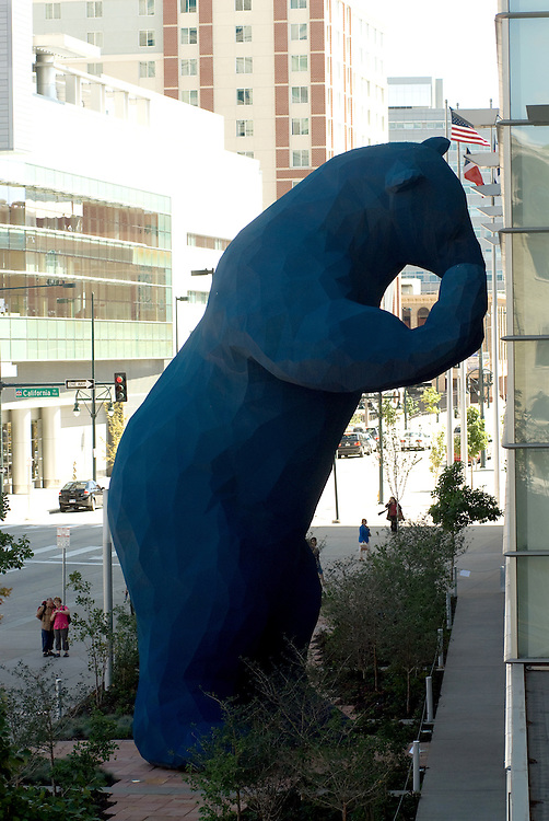 Visitors to the Colorado Convention Center walk near the Blue Bear sculpure in downtown Denver.