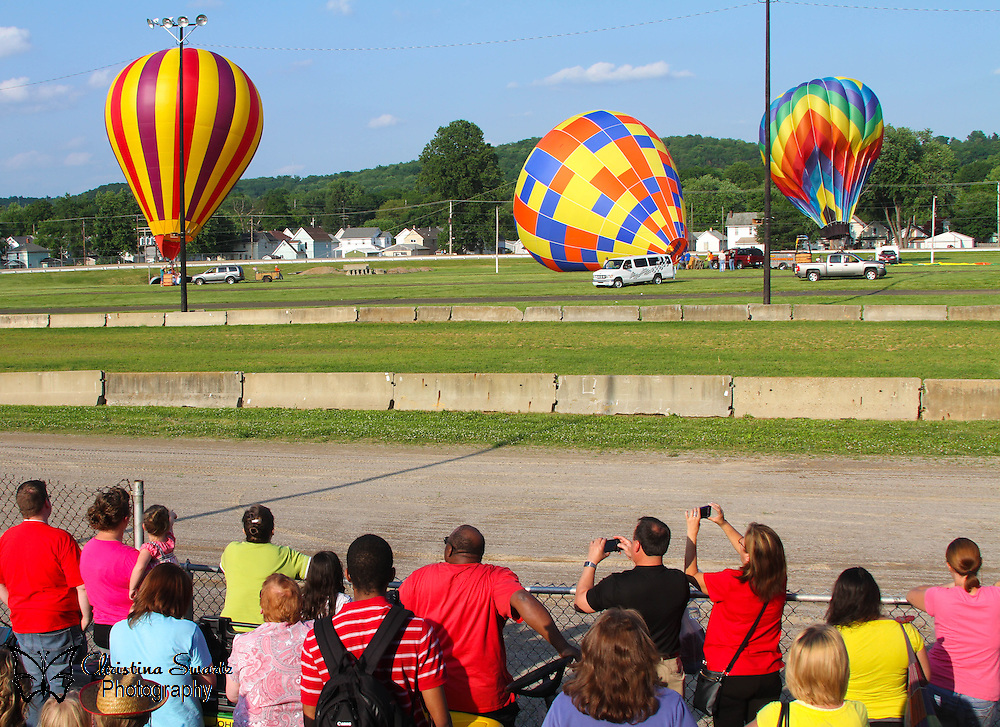 Crowd Watching Hot Air Balloons image for sale, The brothers Joseph-Michel and Jacques-Etienne Montgolfier developed a hot air balloon in Annonay, Ardeche, France, and demonstrated it publicly on June 4, 1783 with an unmanned flight lasting 10 minutes. After experimenting with unmanned balloons and flights with animals, the first balloon flight with humans aboard—a tethered flight—performed on or around October 15, 1783 by Etienne Montgolfier who made at least one tethered flight from the yard of the Reveillon workshop in the Faubourg Saint-Antoine. Later that same day, Pilatre de Rozier became the second human to ascend into the air, to an altitude of 80 ft (24 m) which was the length of the tether