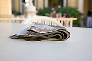 newspaper on a table outside