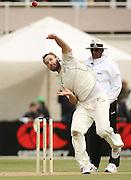 Daniel Vettori in action bowling.<br />New Zealand v West Indies, First Test Match, National Bank Test Series, University Oval, Dunedin, Sunday 14 December 2008. Photo: Andrew Cornaga/PHOTOSPORT