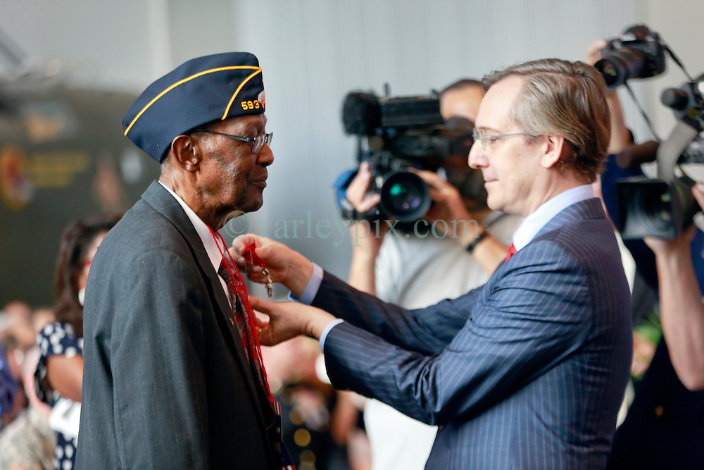 06 June 2014. The National WWII Museum, New Orleans, Lousiana. <br /> WWII veteran Platoon Sgt Lamore Carter, 291st Trucking company is honored with the French Legion of Honor medal by the French Consul General Jean Claude Brunet <br /> Photo; Charlie Varley/varleypix.com