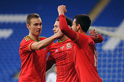 Tom O'Sullivan of Wales u21s (Cardiff City) celebrates his goal with Wes Burns of Wales u21s (Bristol City) and Ryan Hedges of Wales u21s (Swansea City) - Photo mandatory by-line: Dougie Allward/JMP - Mobile: 07966 386802 - 31/03/2015 - SPORT - Football - Cardiff - Cardiff City Stadium - Wales v Bulgaria - U21s International Friendly