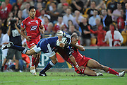 Juan de Jongh dives towards the corner in the tackle of Rod Davies during action from Round 11 of the Super 14 Rugby Union match between the Queensland Reds and the South African Stormers played at Suncorp Stadium on Friday 23 April 2010 ~ ©Image Aura Images.com.au ~ Conditions of Use: This image is intended for Editorial use as news and commentry in print, electronic and online media ~ For any alternative use please contact AURA Images.com.au