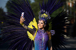 © Licensed to London News Pictures. 26/08/2019. London, UK. A woman in carnival dress poses for a selfie at day two of the Notting Hill carnival. The two day event is the second largest street festival in the world after the Rio Carnival in Brazil, attracting over 1 million people to the streets of West London. Photo credit: Ben Cawthra/LNP