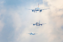 © Licensed to London News Pictures. 27/02/2020. London, UK. Three passenger aircraft are seen together on final approach to London's Heathrow Airport. Earlier, in a ruling at the High Court, judges halted the planned construction of a third runway at the London airport saying the decision was unlawful because it did not take UK climate commitments into account. Photo credit: Peter Macdiarmid/LNP
