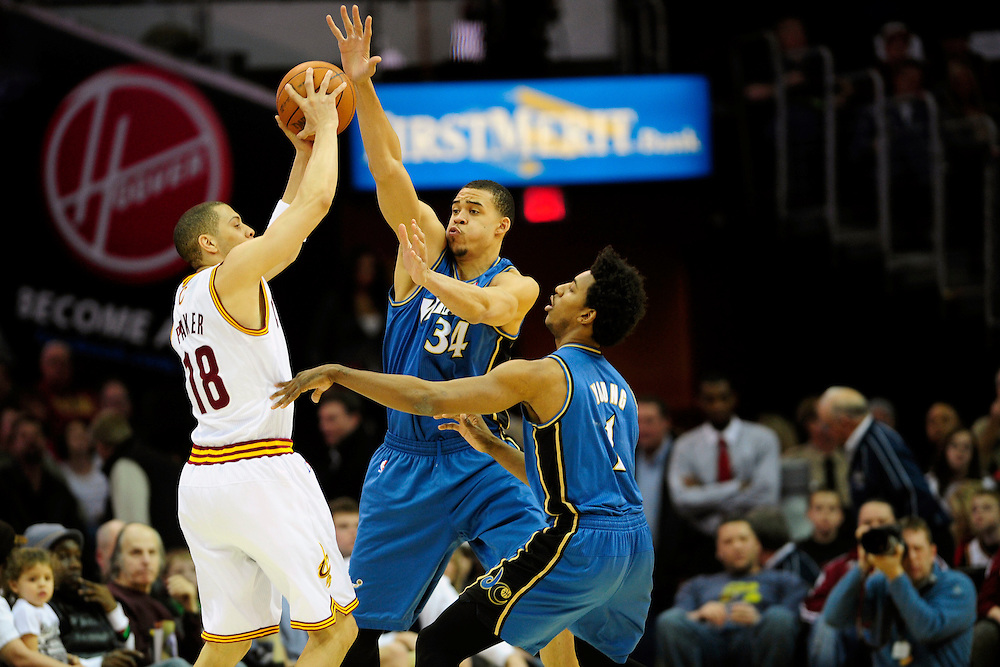 Feb. 13, 2011; Cleveland, OH, USA; Cleveland Cavaliers shooting guard Anthony Parker (18) looks for a pass under pressure from Washington Wizards center JaVale McGee (34) and shooting guard Nick Young (1) at Quicken Loans Arena. Mandatory Credit: Jason Miller-US PRESSWIRE