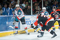 KELOWNA, CANADA - JANUARY 10: Gage Quinney #20 of Kelowna Rockets passes the puck against the Medicine Hat Tigers on January 10, 2015 at Prospera Place in Kelowna, British Columbia, Canada.  (Photo by Marissa Baecker/Shoot the Breeze)  *** Local Caption *** Gage Quinney;