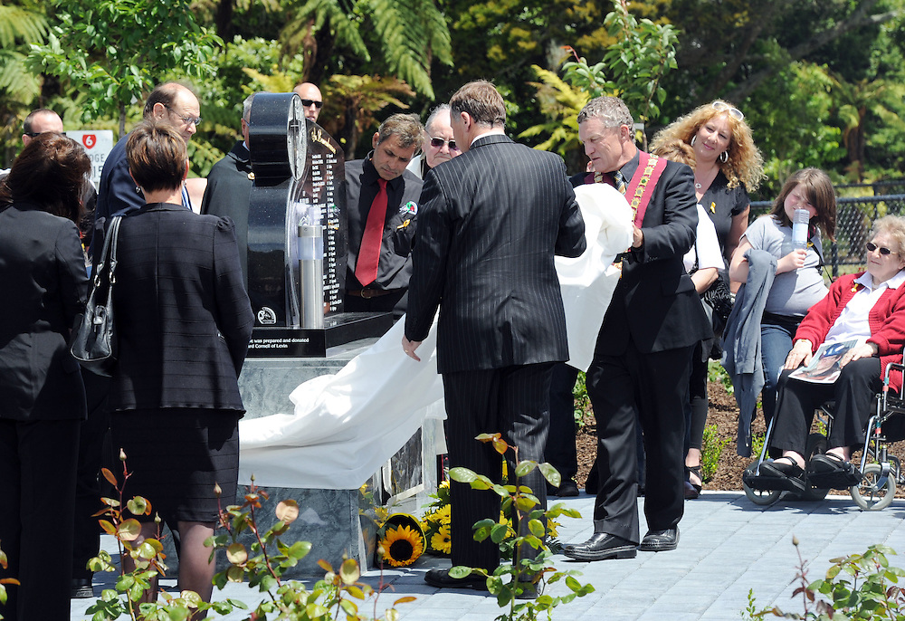Prime Minister John Key and Grey District Mayor Tony Kokshoorn unveil a memorial on the first anniverary for the 29 victims of the Pike River Coal Mine tragedy, Greymouth, New Zeland, Saturday, November 19, 2011. Credit:SNPA / Ross Setford