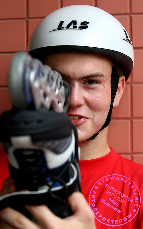 SPECIAL OLYMPICS ATHLETE ROLLER SKATER PIOTR BOSY (POLAND) DURING FIRST DAY COMPETITION IN THE HUANGPU ROLLER SKATING HALL AT THE SPECIAL OLYMPICS WORLD SUMMER GAMES SHANGHAI 2007..SPECIAL OLYMPICS IS AN INTERNATIONAL ORGANIZATION DEDICATED TO EMPOWERING INDIVIDUALS WITH INTELLECTUAL DISABILITIES..SHANGHAI , CHINA , OCTOBER 03, 2007.( PHOTO BY ADAM NURKIEWICZ / MEDIASPORT )..