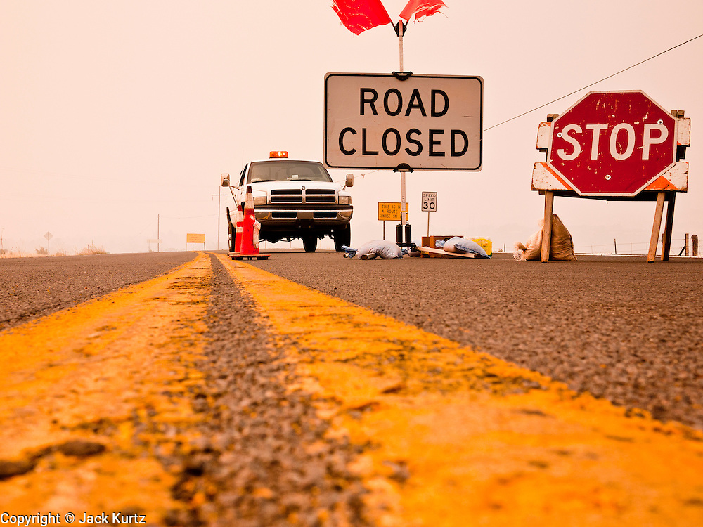 "04 JUNE 2011 - EAGAR, AZ: The roadblock on Highway 261 because of the Wallow Fire. The fire grew to more than 140,000 acres early Saturday with zero containment. A ""Type I"" incident command team has taken command of the fire.   PHOTO BY JACK KURTZ"