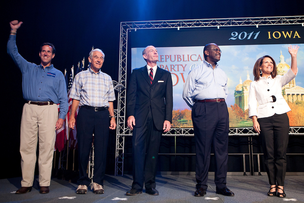 Republican presidential hopefuls Rick Santorum, Ron Paul, Thaddeus McCotter, Herman Cain, and Michele Bachmann, from left, at the Iowa Republican Straw Poll on Saturday, August 13, 2011 in Ames, IA.