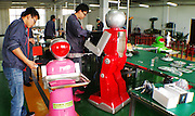 """HARBIN, CHINA - JUNE 07: (CHINA OUT) <br /> <br /> R & D personnels debug robots on June 7, 2015 in Harbin, Heilongjiang province of China. A Haiying robot manufacturer in north China\'s Harbin Harbin Economic and Technological Development Zone has developed into a comprehensive company where multifunctional robots could be made out to work on the land, in water and air. Liu Hasheng, chief manager and founder of the robot manufacturer, opened the first conprehensive robots restaurant in China with \""""waiters\"""" produced by his own company. According to Liu Hasheng, those robot waiters have been sold out throught out country and his orders has also a great business opportunity in the future.<br /> ©Exclusivepix Media"""