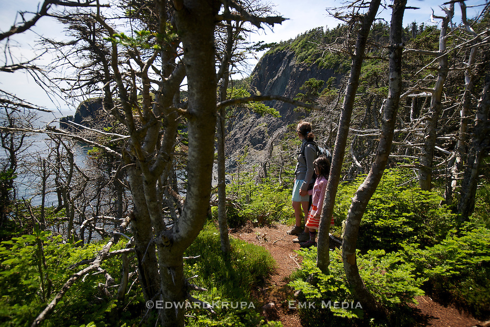 Mother and daughter taking in the view from the high cliffs on the Skerwink Trail in Newfoundland.