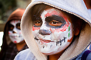 "22 OCTOBER 2011 - PHOENIX, AZ:    Children at an Occupy Phoenix march in downtown Phoenix Saturday. The demonstrations at Occupy Phoenix, AZ, entered their second week Saturday. About 50 people are staying in Cesar Chavez Plaza, in the heart of downtown. The crowd grows in the evening and on weekends. Protesters have coordinated their actions with police and have gotten permission from the city to set up shade shelters and sleep in the park, but without tents or sleeping bags, which is considered ""urban camping,"" instead protesters are sleeping on the sidewalk.  PHOTO BY JACK KURTZ"