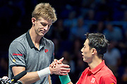 Kevin Anderson of South Africa (left) and Kei Nishikori of Japan shake hands after Kevin Anderson of South Africa wins the match during the Nitto ATP World Tour Finals at the O2 Arena, London, United Kingdom on 13 November 2018.Photo by Martin Cole