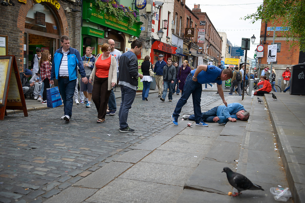I was in the midst of a mild crisis this day, my first in Ireland, because it was my 40th birthday. But this man had fallen and hit his head and nobody could revive him. An ambulance took him away.<br /> <br /> Sometimes our neighbor really is on the side of the road, and many people walk past before someone stops to help.